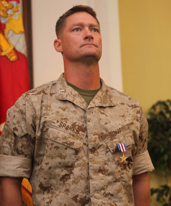 Captain Timothy R. Sparks, former company commander, 1st Battalion, 6th Marine Regiment, 2nd Marine Division, stands at the position of attention while his citation is read after receiving a Silver Star from Brig. Gen. W. Lee. Miller Jr., the acting commanding general of 2nd Marine Division, aboard Marine Corps Base Camp Lejeune N.C., September 28. The Silver Star is the nation's third highest award for combat valor and was presented to Sparks for his actions during his deployment to Helmand Province, Afghanistan in 2010.