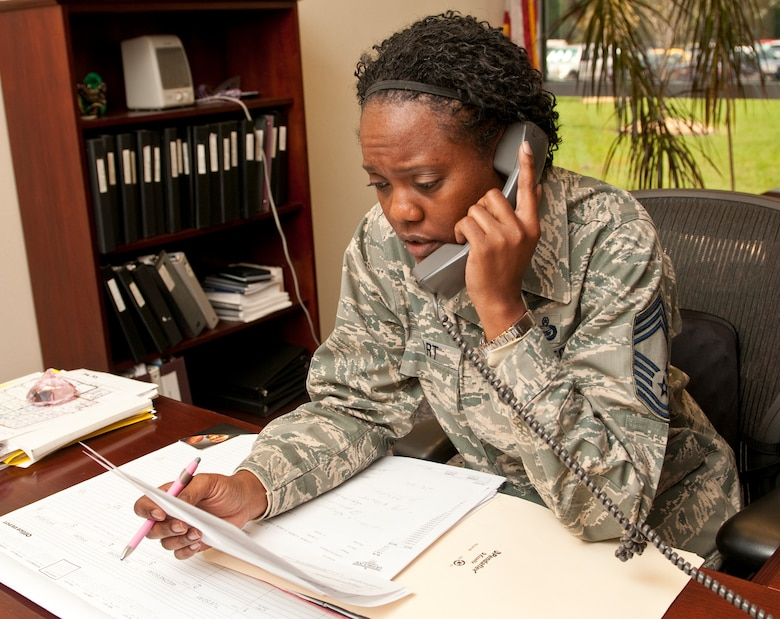 Chief Master Sgt. Kipp Stewart, 116th Force Support Squadron superintendent, works at her desk handling personnel for members of the 116th Air Control Wing, Robins Air Force Base, Ga., Aug. 23, 2011.  As the squadron superintendant, Stewart is responsible for the mentorship and professional development of all assigned enlisted members. (U.S. Air Force photo by Master Sgt. Roger Parsons/Released)