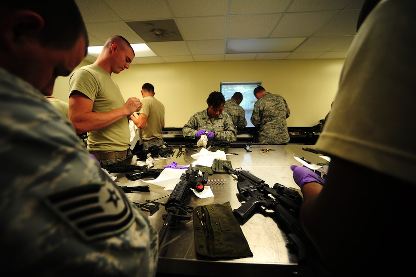 Airmen clean M-4 carbines Sept. 7 at Joint Base Charleston-Air Base, during a Combat Arms Training and Maintenance qualifying course.  (U.S. Air Force photo/Airman 1st Class Matthew Bruch)