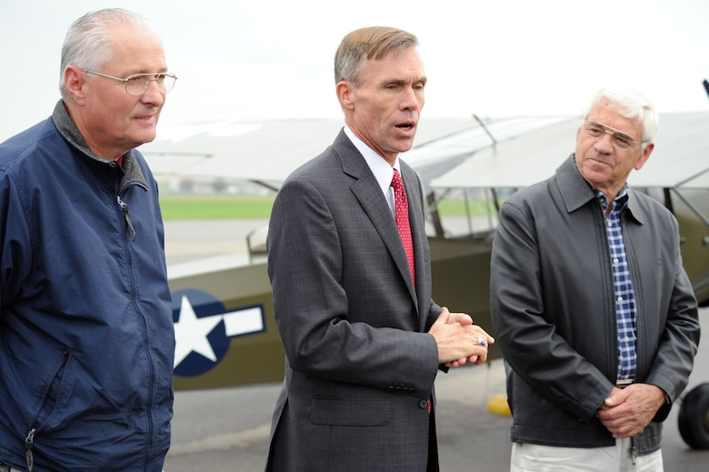 "DAYTON, Ohio -- Lt. Gen. (Ret.) John L. ""Jack"" Hudson (center), director of the National Museum of the U.S. Air Force, addresses the audience after the L-2M made its final flight on Sept. 28, 2011. This L-2M was used at the U.S. Army Air Forces Liaison Pilot Training School during World War II. Also pictured are Dick Valladao (right), the aircraft donor and pilot, and Roger Deere, chief of the museum's Restoration Division. (U.S. Air Force photo by Jeff Fisher)"
