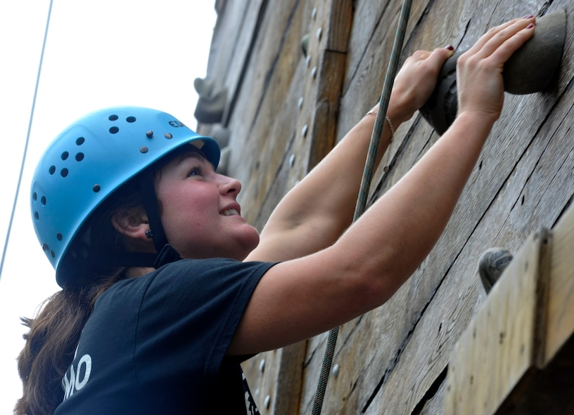 Senior Airman Lyndsie Poole, 779th Medical Operations Squadron occupational therapy apprentice, scales a rock wall during a Joint Base Andrews Chapel Wilderness Retreat exercise Sept. 20. During the activity, Poole achieved a climbing height of more than 50 feet above ground. (U.S. Air Force photo/Airman 1st Class Lindsey A. Beadle)