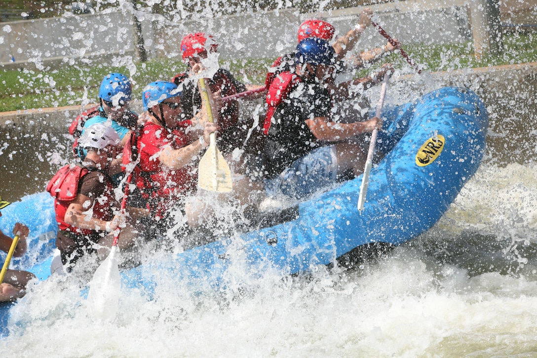 Marines with 1st Battalion, 10th Marine Regiment, 2nd Marine Division, tackle a few waves while whitewater rafting at the U.S. National Whitewater Center in Charlotte, N.C., Sept. 29. The Marines with 1/10 participated in different extreme and outdoor sports as part of Operation Adrenaline Rush, a program geared towards post-deployment stress management.