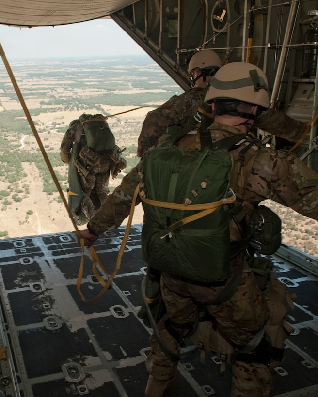 181st Special Operations Weather Team (SOWT), Texas Air National Guard members jump out of a C-130 aircraft belonging to the 136th Airlift Wing during a tactical exercise at Mineral Wells, Texas, Aug. 26, 2011. The SOWT are known for being trained 'thrill junkies' who operate in all six geographic disciplines: mountain, desert, arctic, urban, jungle and water. (U.S. Air Force photo by Senior Master Sgt. Elizabeth Gilbert)