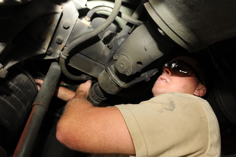 Staff Sgt. Travis Cecil unscrews a nut mounted to an airbag underneath a refueling truck during a maintenance repair at Seymour Johnson Air Force Base, N.C., Sept. 27, 2011. The airbag keeps the truck?s body off the frame to keep it from rubbing against the tires. Cecil is a 4th Logistics Readiness Squadron refueling maintenance technician and a native of New Haven, Ky. (U.S. Air Force photo by Senior Airman Whitney Stanfield)