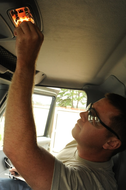 Staff Sgt. Travis Cecil inserts a light bulb inside a refueling truck at Seymour Johnson Air Force Base, N.C., Sept. 27, 2011. The 4th Logistics Readiness Squadron (LRS) vehicle management flight encourages squadrons to alert them to even the smallest problems on government vehicles. Cecil is a 4 LRS refueling maintenance technician and a native of New Haven, Ky. (U.S. Air Force photo by Senior Airman Whitney Stanfield)