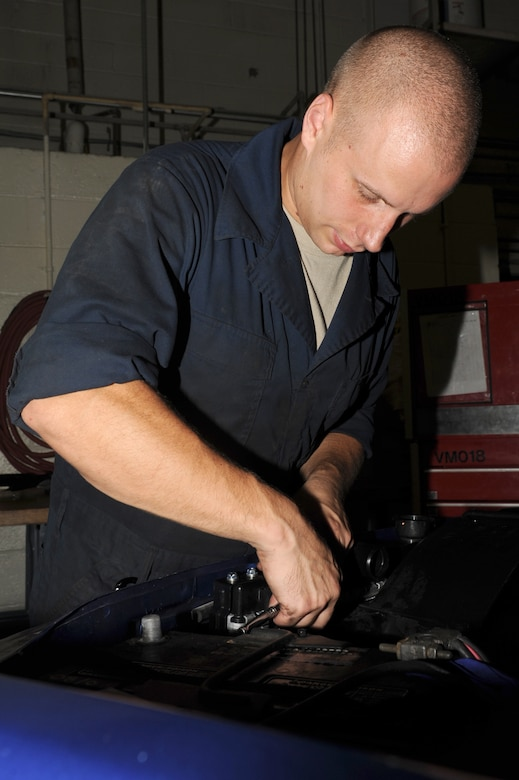 Senior Airman Brian Ball tightens a bolt on a shroud during maintenance repair at Seymour Johnson Air Force Base, N.C., Sept. 27, 2011. A shroud helps direct air through a radiator so it cools. Ball is a 4th Logistics Readiness Squadron vehicle mechanic technician and a native of Carning, N.Y.  (U.S. Air Force photo by Senior Airman Whitney Stanfield)