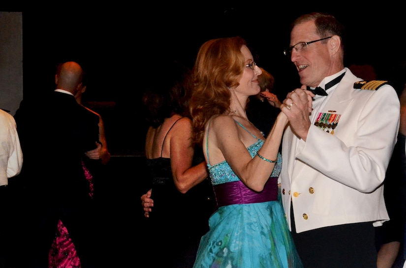 Capt. Steve Brasington and his wife dance the night away during the Joint Base Charleston Military Ball Sept. 24, 2011. The evening consisted of the posting of the Colors by an honor guard made up of all services, dinner, dancing and a presentation from guest speaker Coach Darrin Horn, University of South Carolina Gamecock's head basketball coach. More than 800 service members from across the joint base, encompassing Army, Navy, Air Force and Marine Corps, attended the military ball. Brasington is the Executive Officer of Naval Health Clinic Charleston. (U.S. Air Force photo/2nd Lt. Susan Carlson)