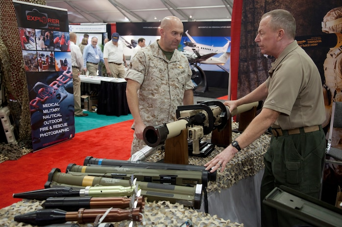 Lt. Col. Paul F. Bertholf with Headquarters Marine Corps checks out the latest weapon technology at a display during the Modern Day Marine Military Exposition at Marine Corps Base Quantico, Va., Sept. 29. Although many of the products were not currently in use by the Corps, the exposition gave vendors the opportunity to promote their products to Marines.