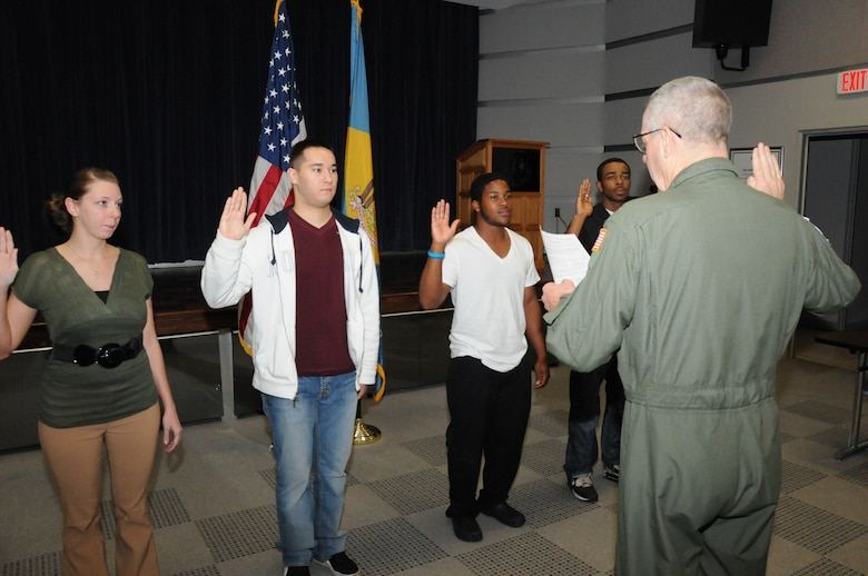 Four new recruits are sworn into the Delaware Air National Guard on Sept. 30, 2011 by 166th Airlift Wing Commander Col. Jonathan Groff inside the unit headquarters in New Castle, Del. Left to Right: Melinda Watson of Newark, Del., John Mason of Pemberton, N.J. (entering vehicle maintenance career field), Wayne Kersey of Dover, Del. (entering the medical field), and Derrick Durroh of Wilm., Del. (entering the aerospace ground equipment career field in maintenance). Each new enlistee will complete Air Force Basic Training in San Antonio, Texas, to be followed by attendance at an Air Force technical school to gain specific career field skills. Wayne Kersey of Dover, Del. is the 400th career recruit enlisted by recruiting supervisor Master Sgt. Gerald Miller, making Sgt. Miller one of the top recruiters in the 65-year history of the unit. The Delaware ANG has 1,100 positions, and is currently hiring for over 15 career fields with several dozen openings within those fields. For information on part-time Air Guard service or available careers, go to www.166aw.ang.af.mil, or www.facebook.com/166thAirliftWing, or call the Delaware ANG recruiting office at 800-742-6713, or 302-323-3444. (U.S. Air Force photo/Tech. Sgt. Harold Herglotz)