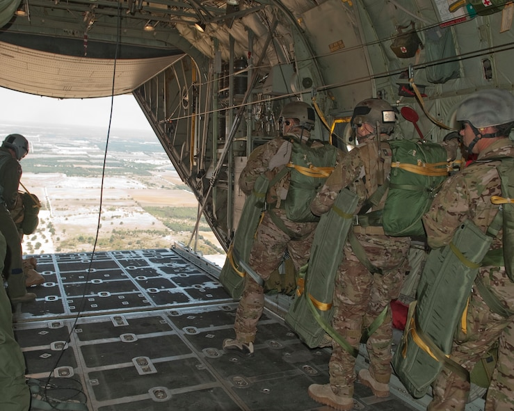 181st Special Operations Weather Team (SOWT), Texas Air National Guard prepare to egress from the C-130 belonging to the 136th Airlift Wing at Mineral Wells, Texas, Aug. 26, 2011. The SOWT have more than 100 pounds of combat gear strapped onto them as part of their gear for austere combat conditions. (U.S. Air Force photo by Senior Master Sgt. Elizabeth Gilbert)