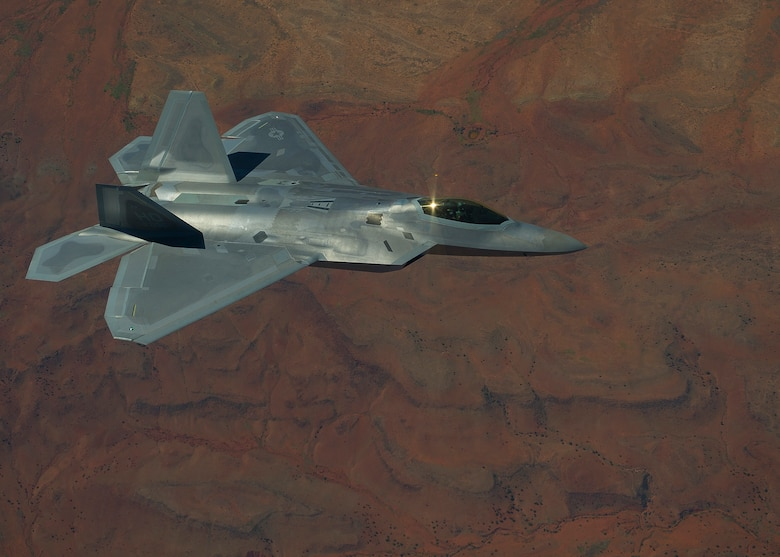 HOLLOMAN AIR FORCE BASE, N.M. -- An F-22 Raptor from the 7th Fighter Squadron flies over the Tularosa Basin during an air to air combat mission Sept. 28, 2011. Two Raptors took flight participating in air to air incursion. (U.S. Air Force photo by Senior Airman John D. Strong II / Released)