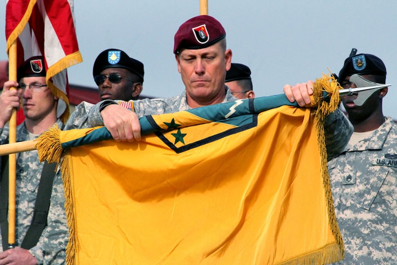 Command Sgt. Maj. James Dickens of the 2nd Engineer Brigade, furls the 3rd Maneuver Enhancement Brigade's colors, signaling the 3rd MEB's inactivation Sept. 21 at Joint Base Elmendorf-Richardson. (U.S. Army photo/2nd Engineer Brigade Public Affairs)