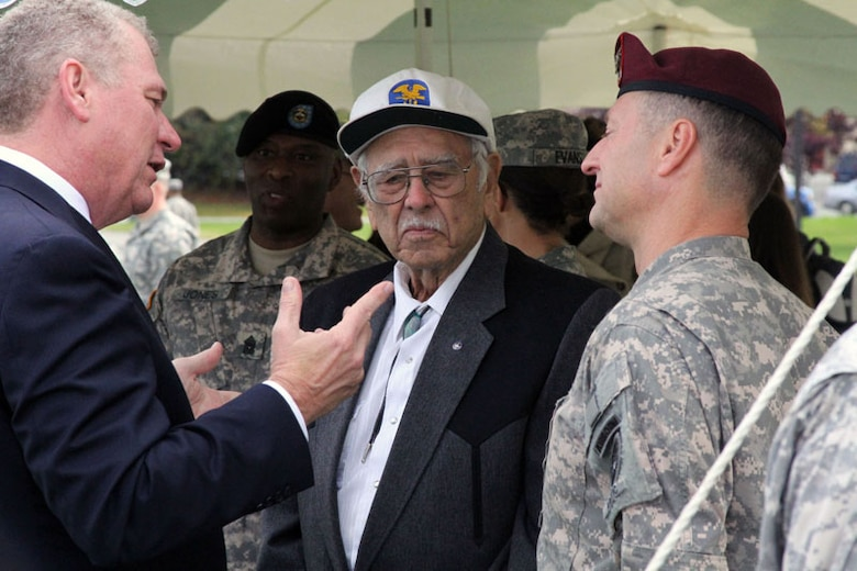Ed Leard, grandson of a 2nd Engineer Amphibious Brigade Soldier killed in World War II, chats with World War II veteran Jack Reed and U.S. Army Alaska Commanding General, Maj. Gen. Raymond Palumbo after the 2nd Engineer Brigade's activation ceremony, Sept. 21, at Joint Base Elmendorf-Richardson's Pershing Field. With a rich history – including 82 combat landings with 15 different assault divisions during World War II – the 2nd Eng. Bde. activates 56 years after the unit last cased its colors.  (U.S. Army photo/2nd Engineer Brigade Public Affairs Office)