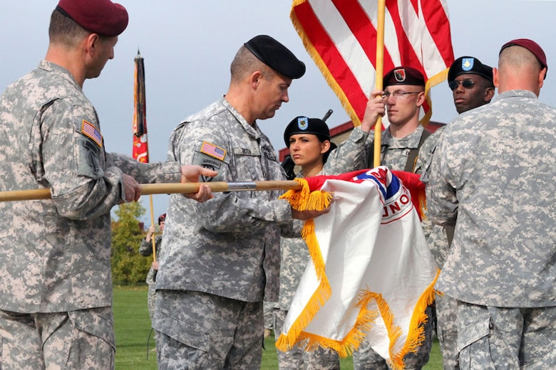 Army Col. Thomas Roth, commander of the 2nd Engineer Brigade, unfurls the newly activated brigade's colors with help from U.S. Army Alaska Commanding General, Maj. Gen. Raymond Palumbo, Sept. 21, at Joint Base Elmendorf-Richardson. The 3rd Maneuver Enhance Brigade, which activated in fall 2009, was inactivated during the ceremony to make way for the new unit. The 2nd Eng. Bde. will command the same units formally headquartered by 3rd MEB.  (U.S. Army photo/2nd Engineer Brigade Public Affairs Office)