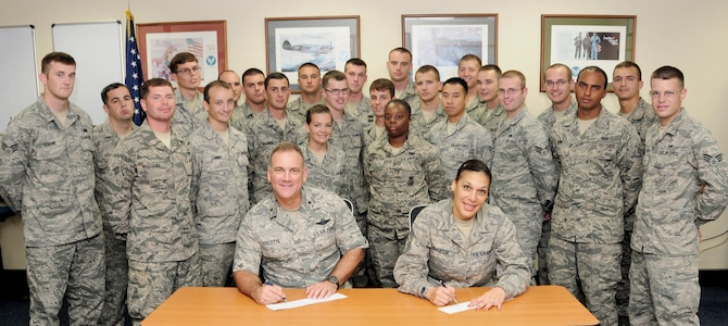"""Brig. Gen. John Doucette, 36th Wing commander, and Chief Master Sgt. Margarita Overton, 36th Wing command chief, make their Air Force Assistance Fund donation with the attendance of Airman Leadership Class 12-C March 28 here. The yearly fund raiser offers Airmen the opportunity to contribute to any of the four official Air Force charitable organizations. This year's AFAF will run through May 4.   AFAF provides an amazing amount of support to Andersen AFB through the Air Force Aid Society This year's motto is """"For the Airmen by the Airmen"""".  Please consider contributing back to AFAS, or one of the other three organizations.  The Air Force Aid Society, which provides Airmen and their families worldwide with emergency financial assistance, education assistance and an array of base-level community-enhancement programs. More information is available at http://www.afas.org/.   The Air Force Enlisted Village, which includes Teresa Village in Fort Walton Beach, Fla., and Bob Hope Village in Shalimar, Fla., near Eglin Air Force Base. The fund provides homes and financial assistance to widows and widowers of retired enlisted people 55 and older. Hawthorn House, also in Shalimar, provides assisted living for residents requiring more assistance than others, including 24-hour nursing care. More information is available at www.afenlistedwidows.org.   Air Force Village, which includes Air Force Village I and II in San Antonio, is a life-care community for retired officers, spouses, widows or widowers and family members. The Air Force Village Web site is www.airforcevillages.com.    The General and Mrs. Curtis E. LeMay Foundation provides rent and financial assistance to widows and widowers of officer and enlisted retirees in their homes and communities through financial grants of assistance. The LeMay Foundation Web site is www.lemay-foundation.org.  To find the unit point of contact or for more information, contact Staff Sgt. Jermaine Smith or 2nd Lt. Harrison Payne a"""