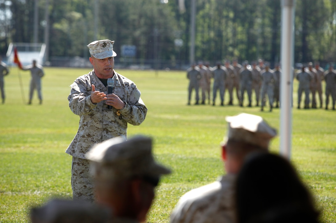 Col. Daniel J. Lecce, commanding officer of Marine Corps Base Camp Lejeune, speaks to service members, families and friends before stepping down as the base commander during the MCB Camp Lejeune and Marine Corps Installations - East re-designation ceremony, April 3.