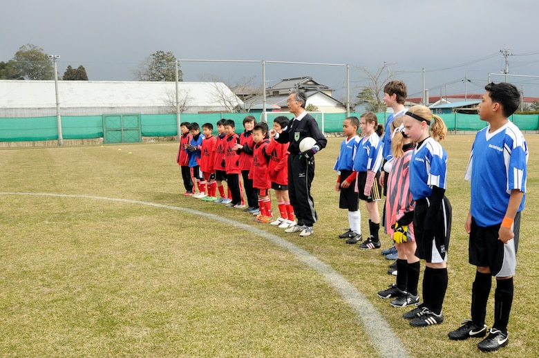 Children from Misawa Air Base and the city of Sendai line up before a joint-youth soccer game at Sendai, Japan, April 1, 2012. Fourteen children from Misawa Air Base were invited to play in a joint-youth soccer game against Japanese children from Sendai to commemorate the centennial of the Japanese gift of more than 3,000 cherry trees to the United States in 1912. (U.S. Air Force photo by 2nd Lt. Son Lee/Released)
