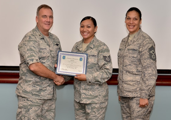 Tech. Sgt. Carrie Cain, 36th Force SupportSquadron professional military education instructor, receives the Air Force level Force Support noncommissioned officer of the  year award from Brig. Gen. John Doucette, March 28. Over the past three years, Sergeant Cain has instructed more than 400 students as an Airman Leadership School instructor. (U.S. Air Force photo by Senior Airman Benjamin Wiseman/Released)