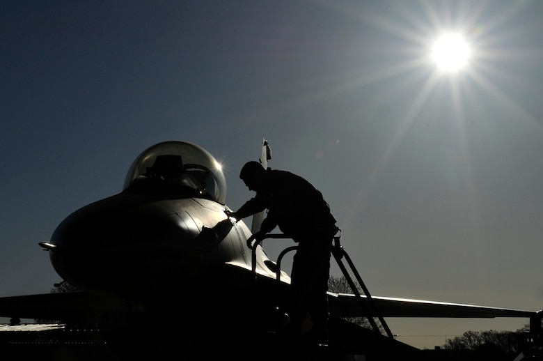 An Airman from the 113th Aircraft Maintenance Squadron prepares an F-16 Fighting Falcon for a training mission April 3, 2012 at Joint Base Andrews, Md. The 113th Wing provides air sovereignty forces to defend the National Capital Region and also provides fighter, airlift and support forces capable of local, national and global employment. (U.S. Air Force Photo/Senior Airman Perry Aston)