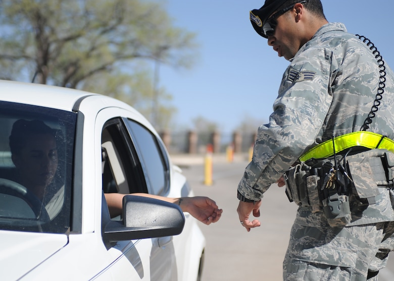 U.S. Air Force Senior Airman Victor Rodriguez, 27th Special Operations Security Forces Squadron patrolman, randomly selects a vehicle for inspection at the main gate at Cannon Air Force Base, N.M., March 27, 2012. Random vehicle inspections are just one way security forces troops ensure the safety of all Air Commandos, families and visitors. (U.S. Air Force photo by Airman 1st Class Eboni Reece)