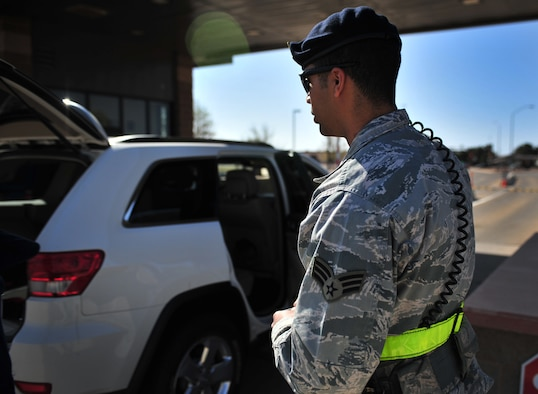 U.S. Air Force Senior Airman Victor Rodriguez, 27th Special Operations Security Forces Squadron patrolman, posts at the main gate to perform random vehicle inspections at Cannon Air Force Base, N.M., March 27, 2012. Security forces troops ensure the safety of all Air Commandos, families and visitors. (U.S. Air Force photo by Airman 1st Class Alexxis Pons Abascal)