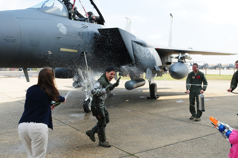 """ROYAL AIR FORCE LAKENHEATH, England – Col. John Quintas, 48th Fighter Wing commander, is sprayed with water and champagne after his """"fini"""" flight April 2, 2012. Quintas took his final flight as the Liberty Wing commander in an F-15E Strike Eagle piloted by Col. Daniel Orcutt, 48th Operations Group commander. (U.S. Air Force photo by Airman 1st Class Cory D. Payne)"""