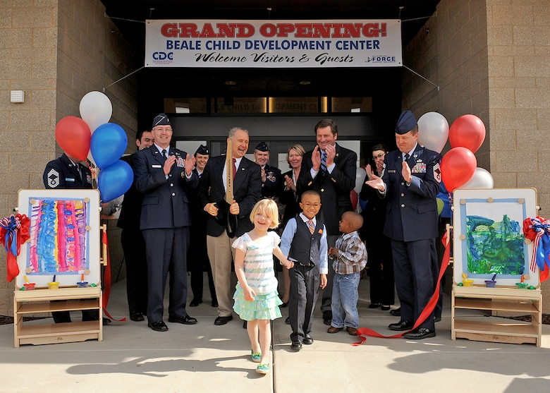Brig. Gen. Paul McGillicuddy, 9th Reconnaissance Wing commander, base leadership, California congressional delegates, and Beale youth cut the ribbon during a ceremony celebrating the new Child Development Center at Beale Air Force Base, Calif. April 2, 2012. The new $15 million CDC, which opened March 26, can accommodate 280 children, ranging from six weeks to five years of age. (U.S. Air Force photo by Mr. John Schwab)