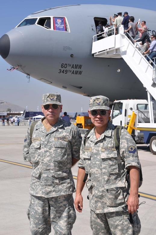 SANTIAGO, Chile – Two Chilean Air Force service members wait their turn to board the KC-10 Extender from the 349th Air Mobility Reserve Wing from Travis AFB, Calif., at FIDAE air show in Santiago, Chile, March 29. The U.S. Air Force's participation in FIDAE illustrates the U.S. commitment to working with regional partners in ways that strengthen friendships, bolster partner nation capacities and expand cooperation between Airmen, which enhances regional security. (U.S. Air Force photo/Master Sgt. Kelly Ogden)