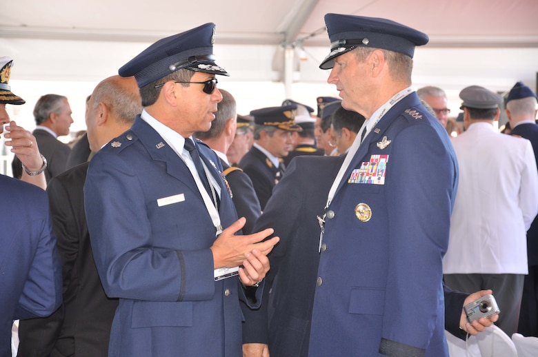 SANTIAGO, Chile – Lt. Col. Frank Ferraro, Air Forces Southern political adviser and Lt. Gen. Robin Rand, 12th Air Force (Air Forces Southern) Commander, take part in inauguration ceremonies at the FIDAE air show in Santiago, Chile, March 27. The U.S. Air Force's participation in FIDAE illustrates the U.S. commitment to working with regional partners in ways that strengthen friendships, bolster partner nation capacities and expand cooperation between Airmen, which enhances regional security. (U.S. Air Force photo/Master Sgt. Kelly Ogden)