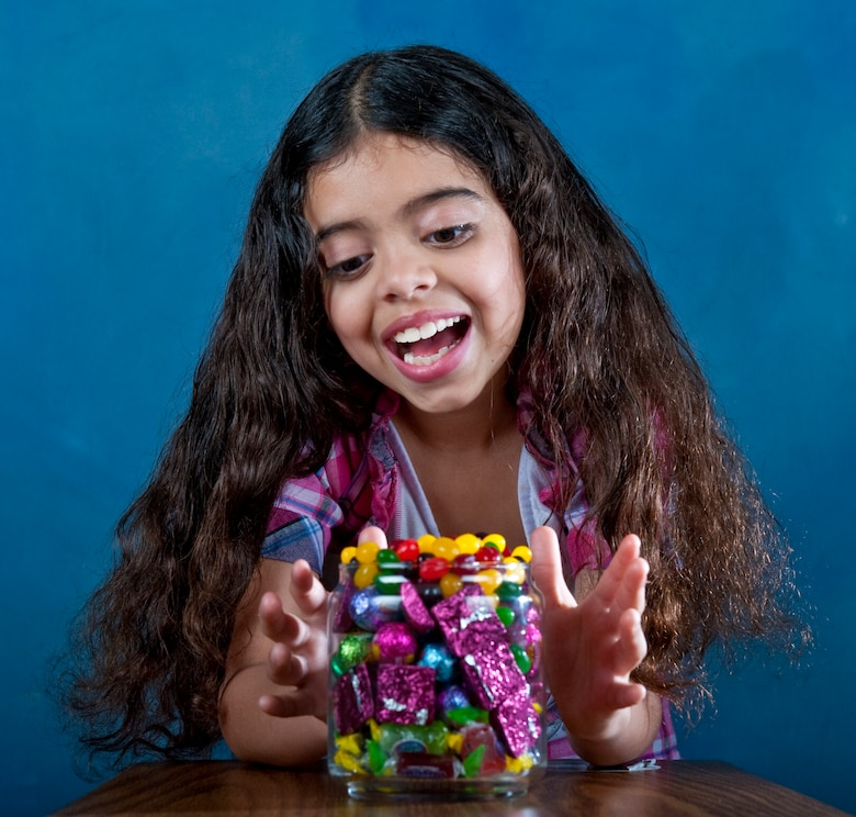 Angelina Bainter poses with a bowl full of candy at Hurlburt Field, Fla., April 3, 2012. Parents should monitor their children's candy intake during the Easter holiday as well as throughout the year. (U.S. Air Force photo/Senior Airman John Bainter)(Released)