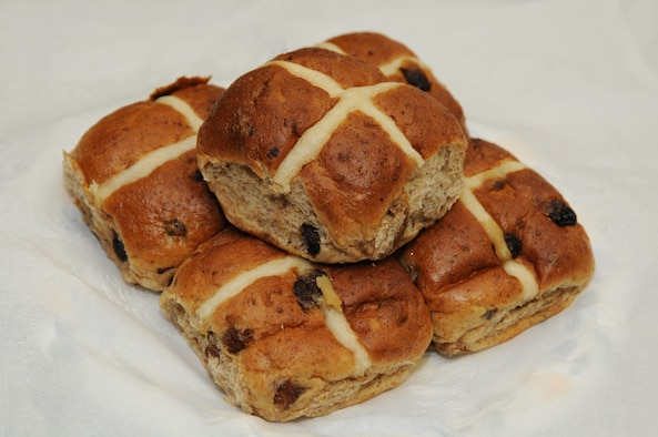 Hot cross buns are a quintessentially British tradition at Easter.They can be eaten warm or split, toasted with butter for breakfast, tea or a snack. No one knows for certain when the tradition began, but in 16th century England, bakers were limited by law to occasions when these special doughs could be made. Good Friday was one; 'cross buns' marked this holy day towards the end of the Lenten fast. (U.S.Air Force photo by Senior Airmen Lausanne Morgan)