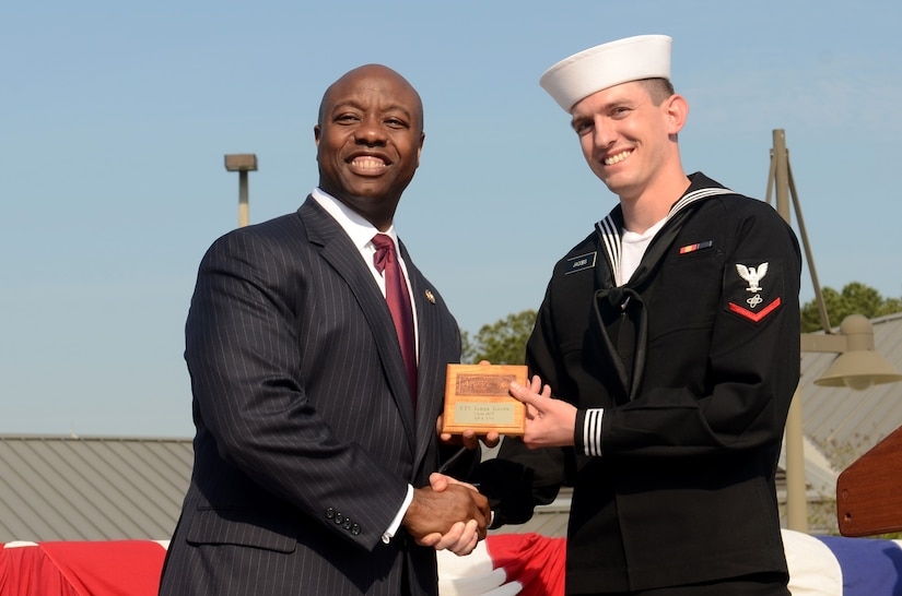 Petty Officer 3rd Class James Jacobs receives the class Honorman award from Rep. Tim Scott during the Naval Nuclear Power Training Command graduation ceremony for class 1107 at Joint Base Charleston – Weapons Station, March 30. The Class Honorman is the Sailor with the highest grade point average for the enlisted class. Scott is the South Carolina first district congressman.  (U.S. Air Force photo/Tech Sgt. Chrissy Best)
