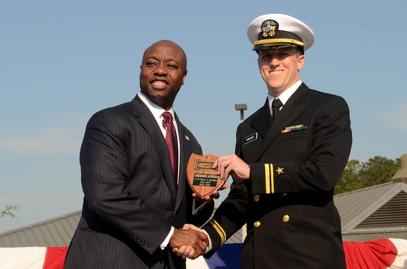 Lt. j.g. Henry Donaghy receives the Vice-Adm. Behrens award from U.S. Rep. Tim Scott during the Naval Nuclear Power Training Command graduation ceremony for class 1107 at Joint Base Charleston – Weapons Station, March 30. The Behrens award recognizes the graduating officer with the highest grade-point average. Scott is the South Carolina first district congressman.  (U.S. Air Force photo/Tech Sgt. Chrissy Best)