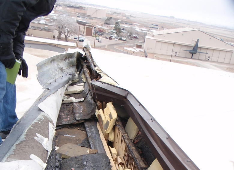 KIRTLAND AIR FORCE BASE, N.M., -- Strong winds in early December 2011 caused damage to the roofs of several buildings.