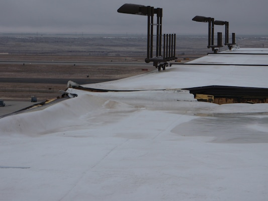 KIRTLAND AIR FORCE BASE, N.M., -- One of the roofs damagaged by strong winds in December 2011.