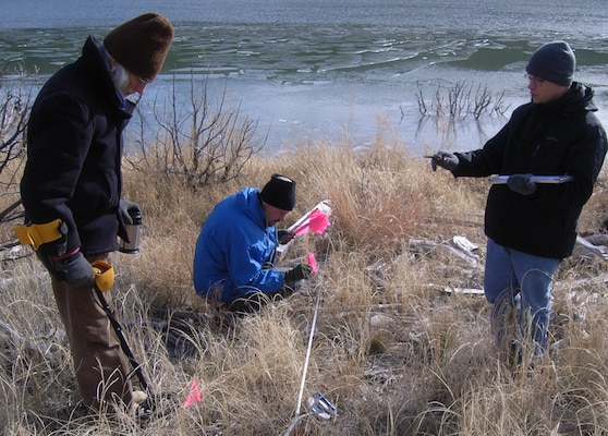 COCHITI LAKE, N.M., -- Albuquerque District archaeologists created an artificial archaeological site along the shore of Cochiti Lake and placed artifacts they made to see the effects from fluctuating lake levels.