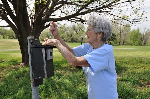 Betty Cunningham tends to the bluebirds at Tinker Golf Course every week, checking on the mothers and their eggs. She records how many eggs are laid and how many are hatched and sends a report to the Oklahoma Department of Wildlife Conservation. She and her late husband, Dean, have fledged more than 800 bluebirds since the inception of the Nest Box Trail project in 1989. (Air Force photos by Kimberly Woodruff)