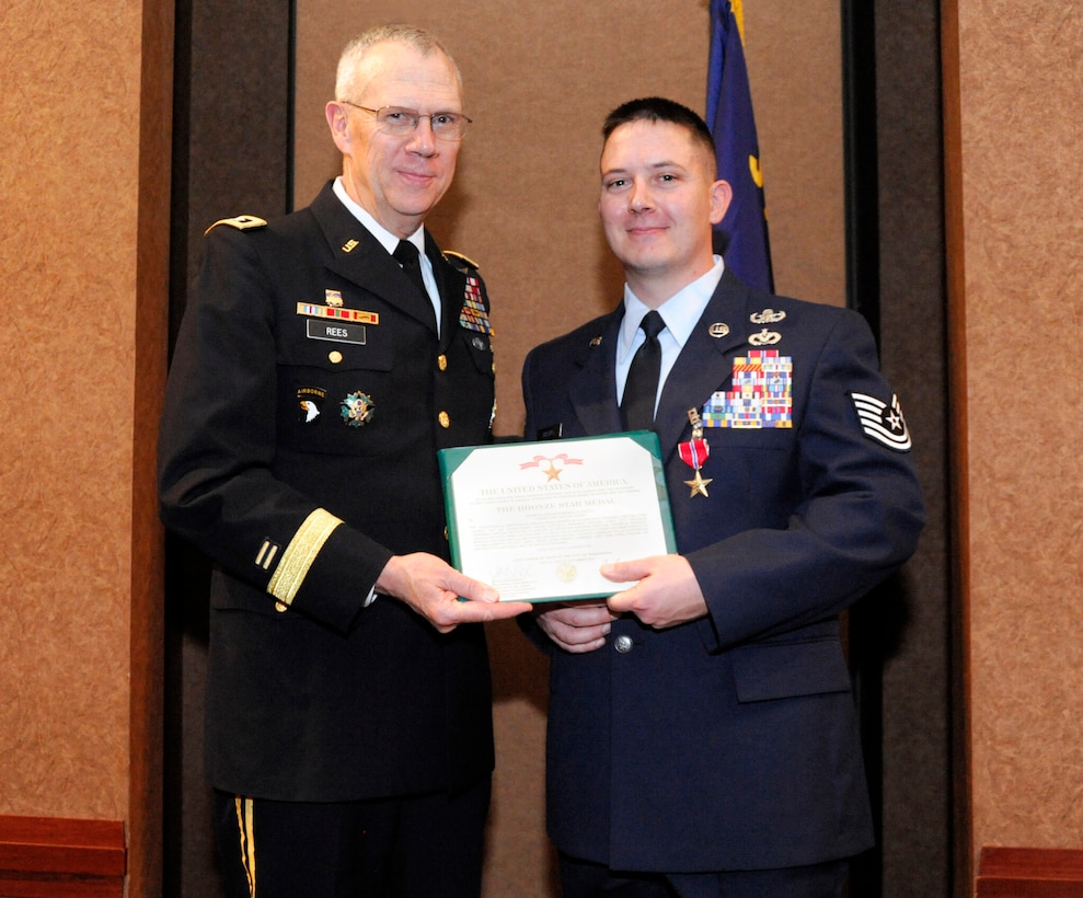 """Maj. Gen. Raymond Rees, Adjutant General for the State of Oregon, presents the Bronze Star Medal and certificate to Tech. Sgt. Mendell """"Trey"""" Holley, Feb. 27, 2010, at the Oregon Air National Guard Awards Banquet, Portland, Ore. (stock photo by Tech. Sgt. Greg Neuleib (ret.) 142nd Fighter Wing Public Affairs Department)"""