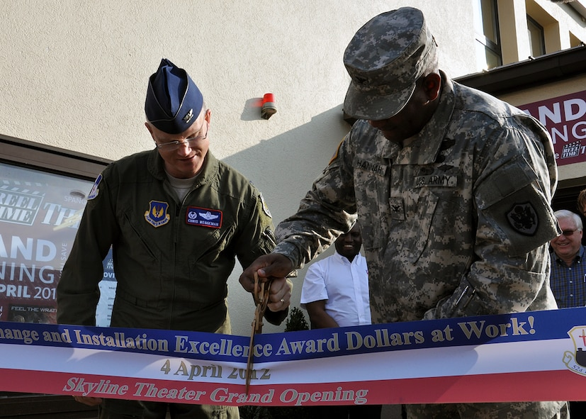 SPANGDAHLEM AIR BASE, Germany – U.S. Air Force Col. Chris Weggeman, 52nd Fighter Wing commander, and U.S. Army Col. Fred Hannah, Exchange Europe commander, cut a ribbon during a ribbon-cutting ceremony at the Spangdahlem Skyline Theater grand reopening here April 4. The two organizations jointly renovated and upgraded the facility through shared financial contributions. The 52nd FW spent $575,850 of the Commander in Chief's 2011Installation Excellence award money for building renovations, and the Exchange spent $350,000 for system upgrades. This is the first Exchange theater in the world to have 3-D capabilities and full digital audio and video. (U.S. Air Force photo by Staff Sgt. Daryl Knee/Released)