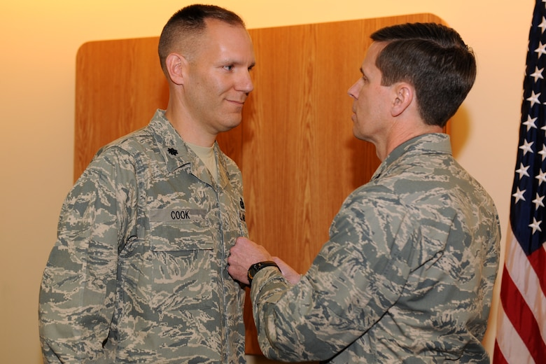 Lt. Col. Edward Cook (left), Commander, 174th Fighter Wing Logistics Readiness Squadron, is presented the Bronze Star medal by 174th Fighter Wing Commander Col. Greg Semmel, during a ceremony held on 31 March 2012 at Hancock Field Air National Guard Base, Syracuse, NY.  Cook received the Bronze Star for exceptionally meritorious service as the Director of Joint Logistics, Combined Forces Special Operations Component Command, while deployed to Afghanistan from August 2011-Feb 2012. (NY Air National Guard Photo by: Staff Sgt. James N. Faso II, Released)