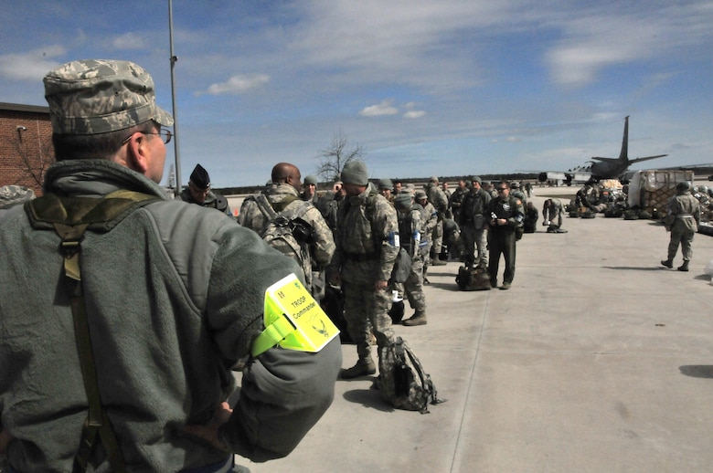 Lt. Col Douglas Hartley, 107th Airlift Wing Communications Flight Commander, oversees Airmen upon arrival at Alpena Combat Readiness Training Center for an Operational Readiness Exercise. (U.S. Air Force photo Tech. Sgt. Justin Huett)