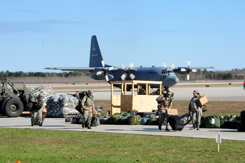 Airmen collect baggage shortly after arriving at Alpena, Michigan Combat Readiness Training Center and prepare for a training exercise.  Exercises such as these ensure Airmen are current, qualified, and ready to fight. (U.S. Air Force photo by Senior Airman Jessica Mae Snow)