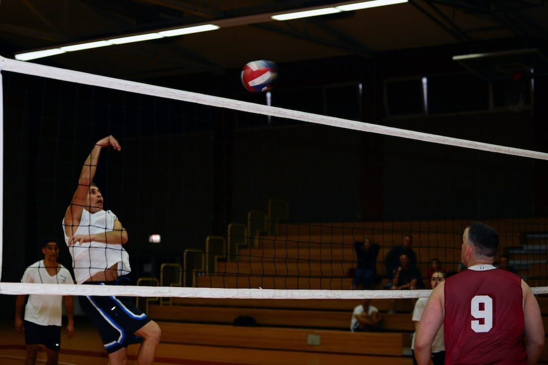 SPANGDAHLEM AIR BASE, Germany – Jose Becerra, 606th Air Control Squadron, returns a volleyball over the net during the intramural volleyball championship game at the Skelton Memorial Fitness Center here April 3. ACS defeated the 702nd 21-25, 25-19 and 15-8 in the final game of the double-elimination tournament. The tournament included nine teams comprised of Airmen and family members from different squadrons throughout Spangdahlem AB. (U.S. Air Force photo by Airman 1st Class Dillon Davis/Released)