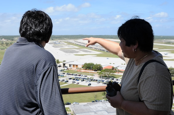 """ANDERSEN AIR FORCE BASE, Guam- Honorable Ronald """"Ron"""" J. Flores (Left) Vice Mayor of Yigo, Guam, and Honorable Melissa B. Savares, Mayor of Dededo, Guam, overlook the base from the air traffic control tower during a visit April 3. The mayor from Dededo and vice mayors from Dededo and Yigo visited Team Andersen to discuss flight operations with senior officials and to discuss more ways the base and community could continue to work together. (U.S. Air Force photo/Senior Airman Carlin Leslie)"""