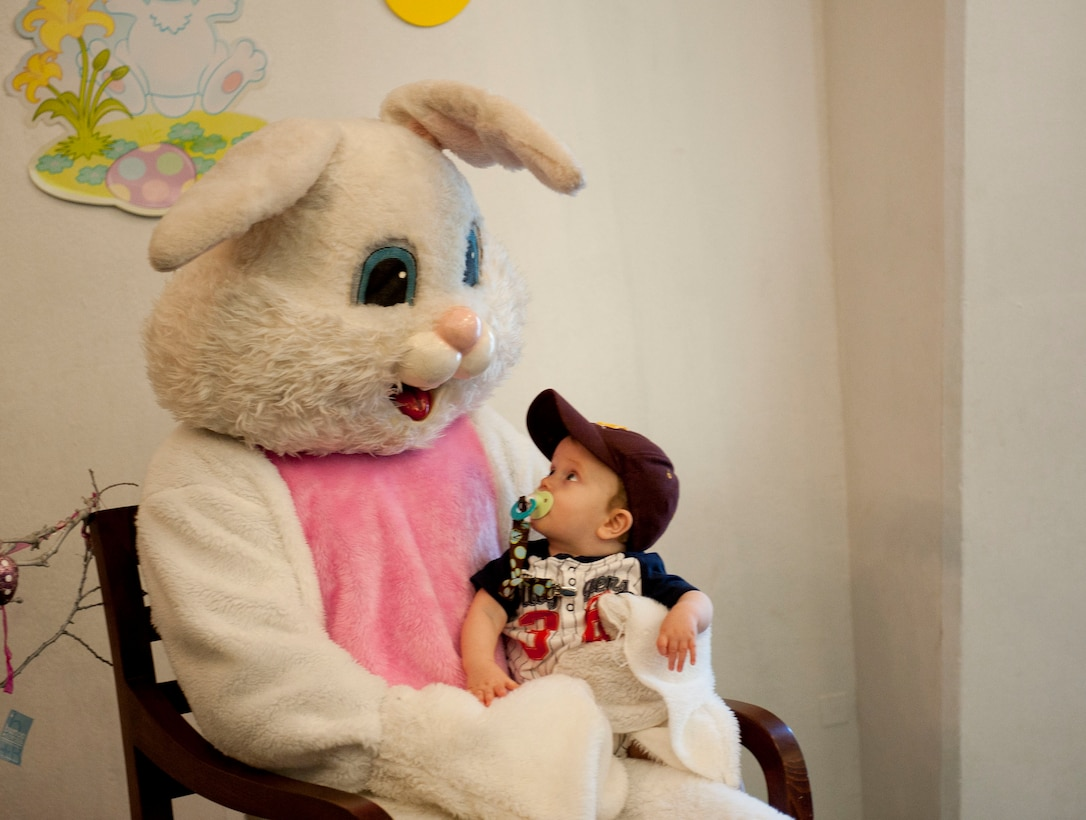 A child poses for a photo with the Easter bunny at the Easter Bunny Kids at Play event April 4, 2012, at Incirlik Air Base, Turkey. The event was hosted by the 39th Force Support Squadron and included various arts and crafts, games, and an egg hunt. (U.S. Air Force photo by Senior Airman Clayton Lenhardt/Released)