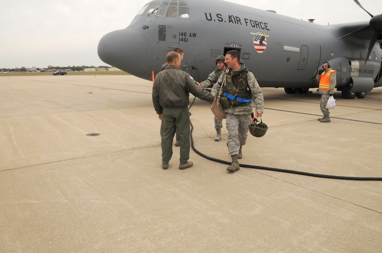 Servicemembers of the 110th Airlift Wing, Battle Creek, Mich., arrive home from Volk Field, Wis. after completing the Wing's first Air Mobility Command Operational Readiness Inspection on Tuesday, Oct. 18, 2011. (U.S. Air Force photo by Master Sgt. Sonia Pawloski/released)