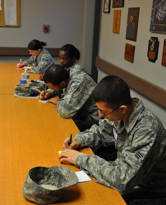 Team Beale Airmen write down concerns they would like to see addressed by wing and Air Force leadership during the Caring For People Forum at Beale Air Force Base, Calif., March 30, 2012. Issues ranged from housing allowance to after school youth programs. (U.S. Air Force photo by Staff Sgt. Robert M. Trujillo/Released)