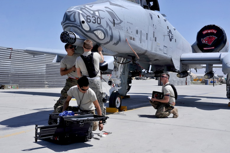A 455th Expeditionary Aircraft Maintenance Squadron crew works as a team repairing an A-10 Thunderbolt at Bagram Airfield, Afghanistan, April 6, 2012. The 455th EAMXS is responsible for repairing and maintaining military aircraft on Bagram as well as performing preventative maintenance inspections. (U.S. Air Force photo/Airman 1st Class Ericka Engblom)