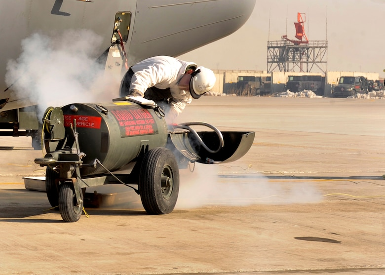 A 455th Expeditionary Aircraft Maintenance Squadron aircraft maintainer adds liquid oxygen to an EC-130 aircraft at Bagram Airfield, Afghanistan, Jan. 2011. The 455th EAMXS is responsible for preparing military aircraft on Bagram for flight and returning them to a mission-ready state once they land. (U.S. Air Force photo/Airman 1st Class Ericka Engblom)
