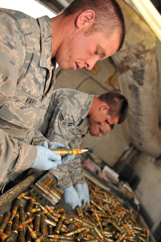 Staff Sgt. Glen Vart, 455th Expeditionary Maintenance Squadron Ammunition Supply Point technician, inspects 20 mm rounds to ensure they are serviceable at Bagram Airfield, Afghanistan, March 23, 2011. All ammunition must be inspected before being loaded to avoid deficient-round mishaps. (U.S. Air Force photo by Senior Airman Sheila deVera)